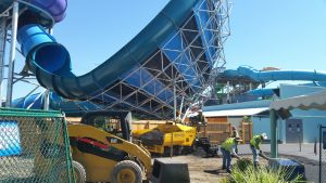 Crew working on parking lot at the Six Flags in Denver